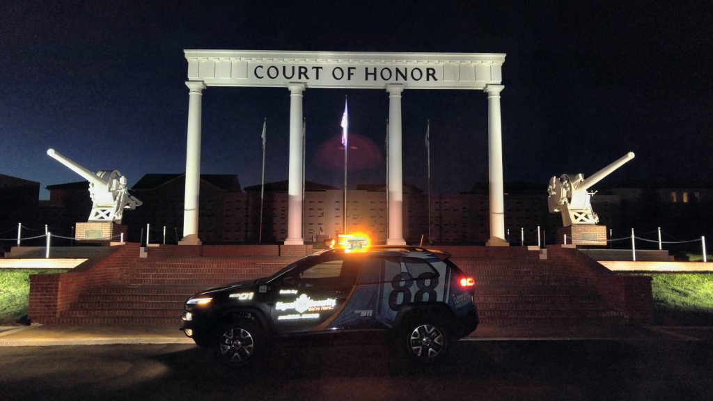 A Signal 88 patrol car providing government security services for a court house